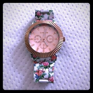 Bebe floral watch with rose gold tone face.